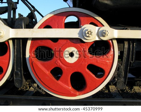 Closeup of the main drive wheel of an old railroad steam engine.