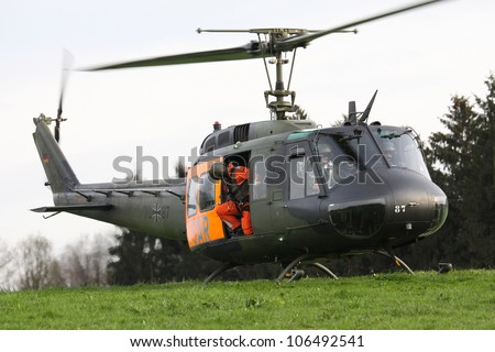 Closeup of the military helicopter with the Pilots
