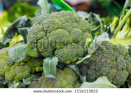 Closeup of the pile of broccoli on the market