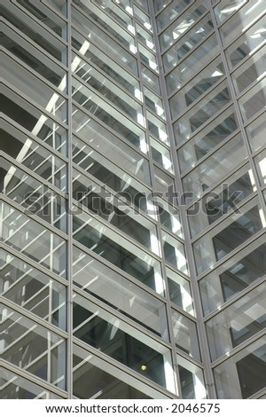 Closeup of the windows on an atrium on a skyscraper