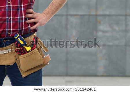 closeup of the worker with tools belt #581142481