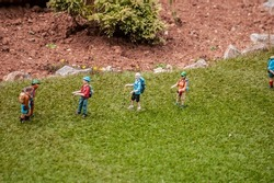 Closeup of tiny model hikers at a model village in England