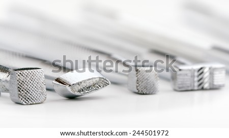 stock-photo-closeup-of-tools-for-leather-stamping-on-white-244501972.jpg