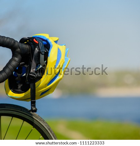 Closeup of touring sportive bike and helmet on nature background #1111223333