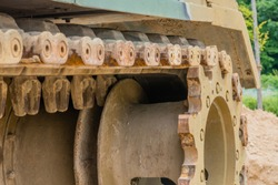 Closeup of tracks and sprocket on tank used in Korean war on display in public park.
