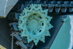 Closeup of tracks and sprocket wheel on LVT3C amphibious armored personnel carrier.