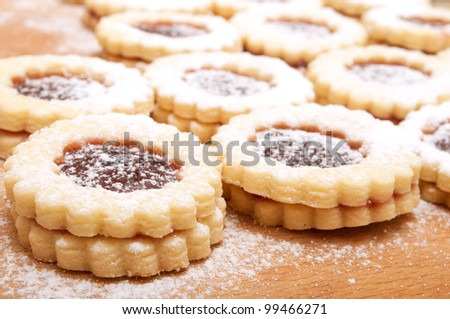 Closeup of Traditional Linzer Cookies on Wooden Board