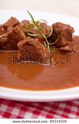 Closeup of Traditional Venison Goulash on White Plate