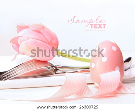 stock photo : Closeup of tulip and utensils on pale pink background