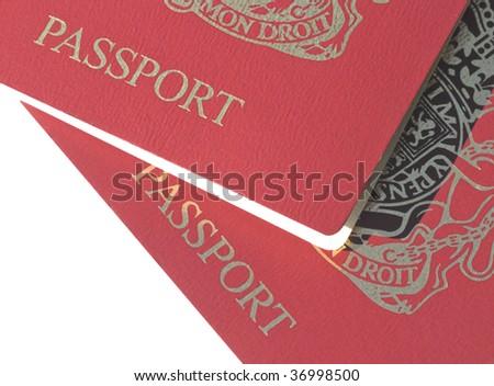 Closeup of two British passports over white - stock photo
