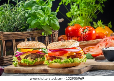 Closeup of two burgers made �¢??�¢??from fresh vegetables
