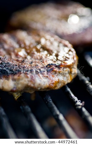 Closeup of two burgers on the barbecue