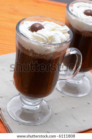 Closeup of two cups of coffee with cream (Caffe Borgia)