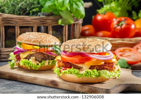 Closeup of two homemade burgers made �¢??�¢??from fresh vegetables