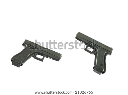 Closeup of two pistols isolated over a white background
