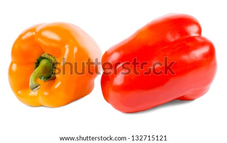 Closeup of two red and orange sweet bell peppers, or capsicum, used as a flavouring ingredient in cooking and salads on a white background
