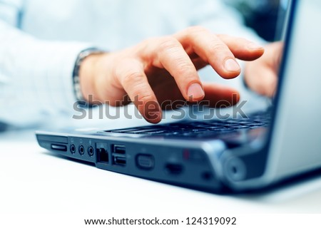 Closeup of typing male hands