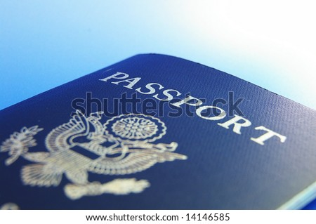 Closeup of U.S. passport, on blue background