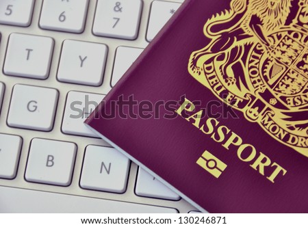 Closeup of UK passport resting on computer keyboard