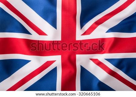 Closeup of Union Jack flag. UK Flag. British Union Jack flag blowing in the wind.  #320665106