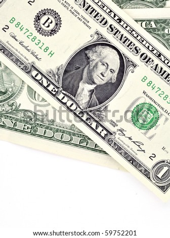Closeup of US Dollar banknotes over white