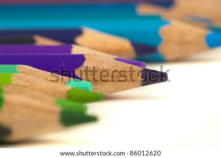 closeup of various crayons on a white background