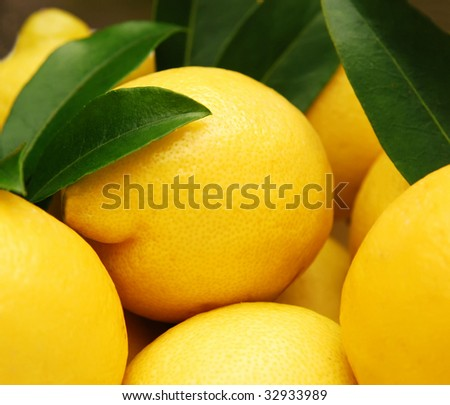 closeup of vibrant yellow lemons, shallow depth of field