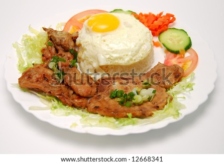 Closeup of vietnamese food: steamed rice dish with fried egg and BBQ pork - stock photo