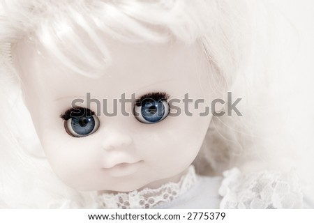 Closeup of vintage doll\'s face with blue eyes