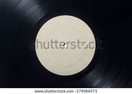 Closeup of Vinyl Long Play Record with Label with Copy Space.