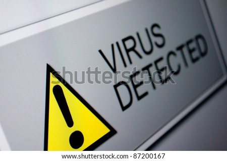 Closeup of Virus Detected Sign on LCD Screen