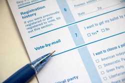 Closeup of voter registration form, Vote-by-Mail section, with a pencil on top