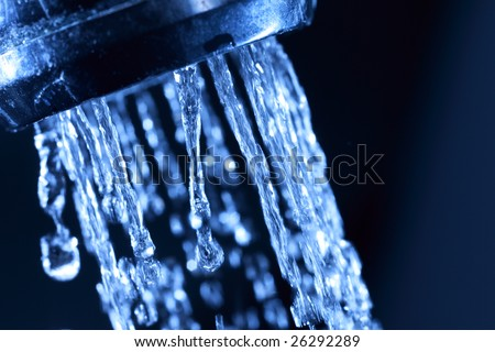 Closeup of water coming from a kitchen sink
