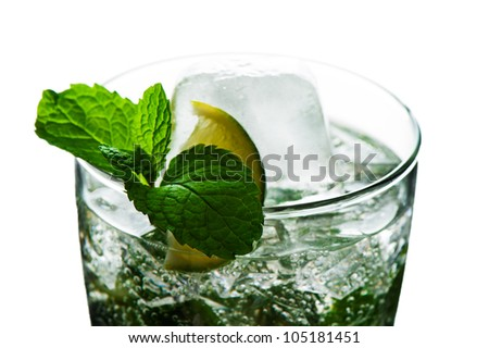 Closeup of water with limes and mint on White background