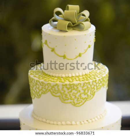 Closeup of wedding cake top with detailed icing at reception