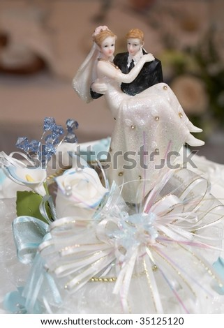 stock photo Closeup of wedding cake topper figurines at reception