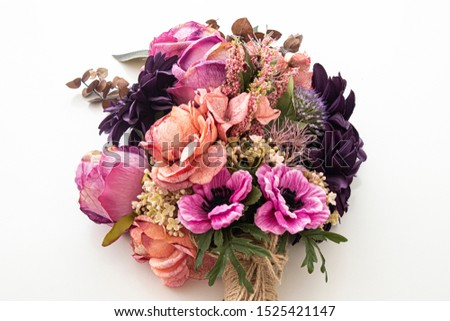 Closeup of wedding flowers, bridal bouquet. Decoration made of roses, peonies and decorative plants, close-up, selective focus, nobody, objects