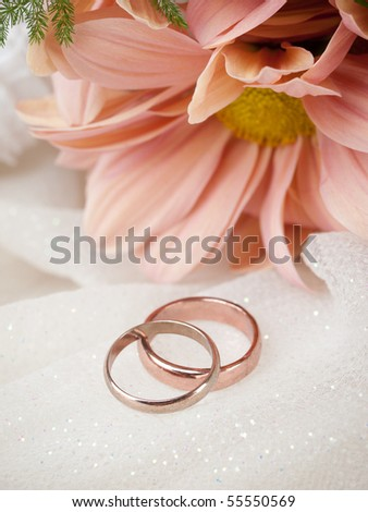 stock photo Closeup of wedding rings and flowers