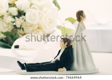 stock photo Closeup of whimsical wedding cake figurines on white