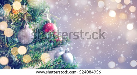 Closeup of white bauble hanging from a decorated Christmas tree with bokeh, copy space, Xmas holiday background. #524084956