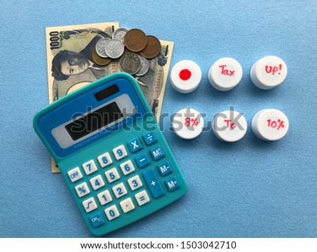 Closeup of white bottle caps with hand writing texts, calculator and Yen money on blue background to remind about Japanese consumption tax will increase to 10% in October 2019. For money concept. #1503042710