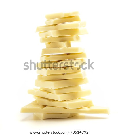 closeup of white chocolate pieces on white background - stock photo