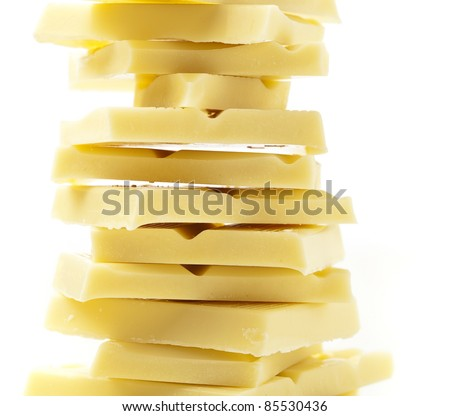 closeup of white chocolate pieces on white background