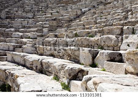 closeup of white steps of ancient Greek amphitheatre, Segesta village, Sicily, Italy