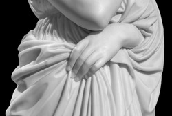 Closeup of white stone marble statue woman hand holding a tunic isolated on black background