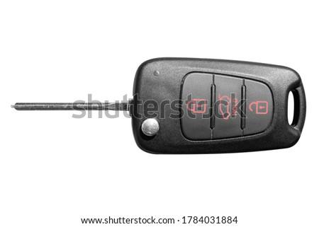 Closeup of wireless key ignition isolated on white background. Wireless start engine key. Car key remote isolated over white. Modern car keys. Car keys close up.