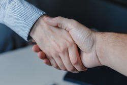 Closeup of woman and man business handshake. Hands together. Work agreement and colaboration, Successful negotiantion and cooperation. Business, freelance, job concept