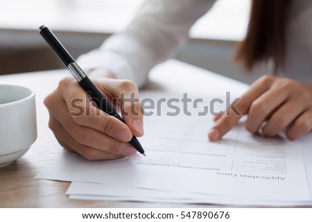Closeup of Woman Completing Application Form