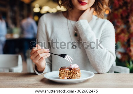 closeup of woman eating...