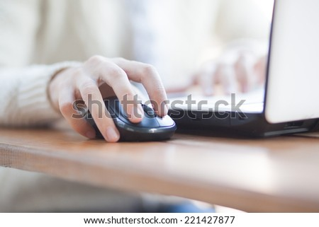 Photo of  Closeup of woman hand clicking mouse outdoor